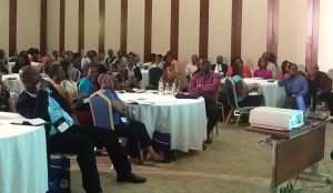 Participants at the JEF session, being addressed on the benefits of the equity market in Jamaica by John Jackson in May.