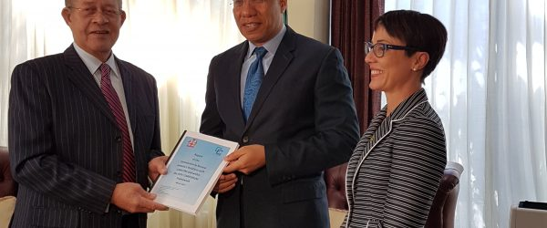 Golding hands over Caricom report